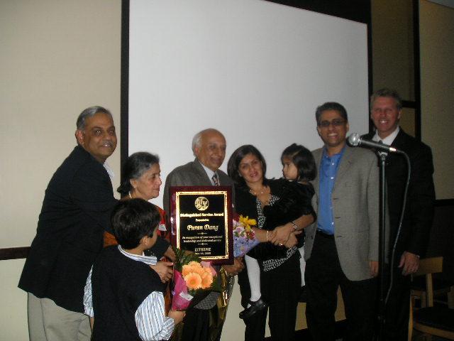 Puran Dang Gets Distinguished Service Award